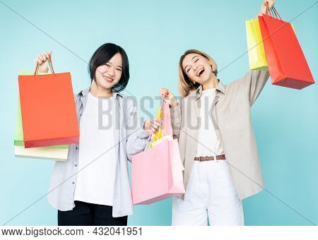 Happy Shopping. Female Friends. Black Friday Sale. Shopaholic Lifestyle. Pretty Excited Asian Caucas