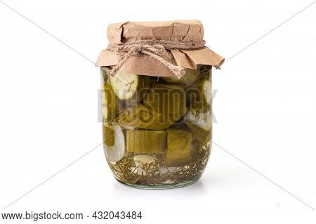 Preserved cucumbers in glass jar. Isolated on white background