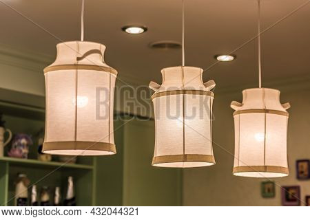 Pendant Lamps Made Of Fabric In Shape Of Milk Cans In Kitchen Interior