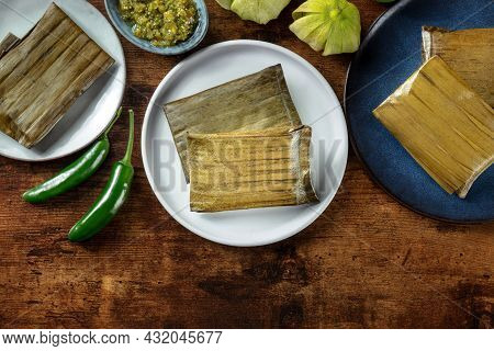Tamales Oaxaquenos, Traditional Dish Of The Cuisine Of Mexico, Various Stuffings Wrapped In Green Le