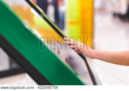 Woman Hand Uses Digital Touch Screen To Get Information.