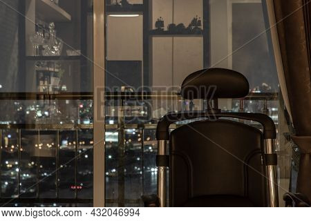 Comfort Chair In Living Room And City View At Home, Condominium In The Evening At Sunset. Living Lif