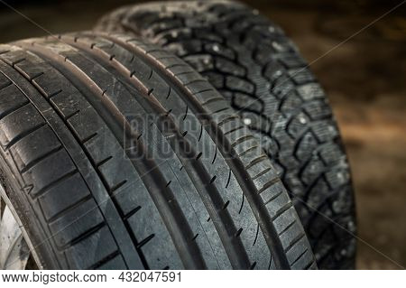 Winter Studded And Summer Car Tires. Change Of Wheels According To The Season