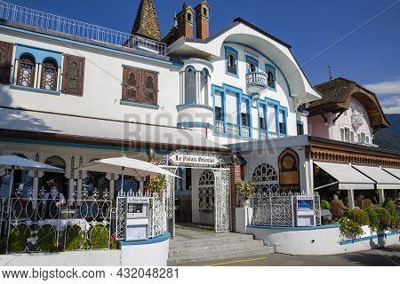 Switzerland, Montreux, August, 2021 - Restaurant Le Palais Oriental With Visitors On The Shores Of L