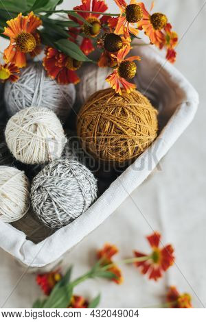 Cozy Balls Of Yarn For Knitting In A Basket. Background For Handmade And Slow Homelife. Place For Te