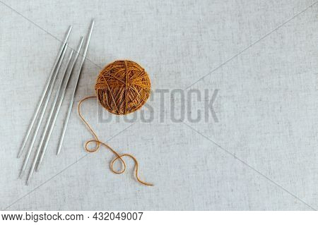 Cozy Ball Of Yarn And Needles For Knitting. Background For Handmade And Slow Homelife. Place For Tex