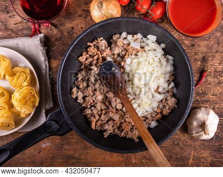 Cooking American-italian Pasta With Sausage Stew - Frying Pan With Cooking Stew And Ingredients For