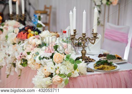 Antique Candlestick With Wedding Bouquet.wedding Candlestick With Flower Decoration Before Wedding C
