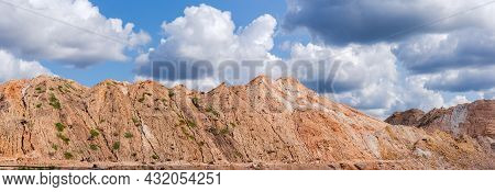 Old Colored Rock Dumps In Quarry For The Extraction Of Ilmenite Ore Against The Sky With Clouds, Pan