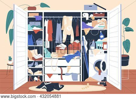 Messy Wardrobe Full Of Untidy Clothes Piles. Mess And Clutter Inside Open Closet. Chaos, Disorder An