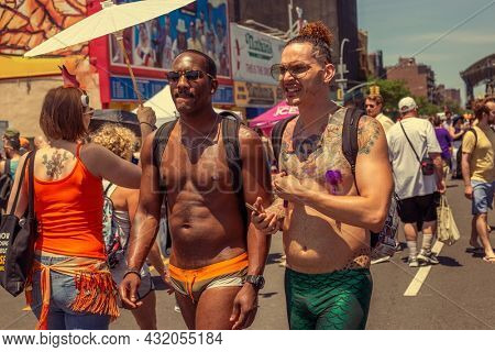 June18, 2013 Coney Island, USA. Mermaid Parade. A couple of gay man walking on the street together in costume