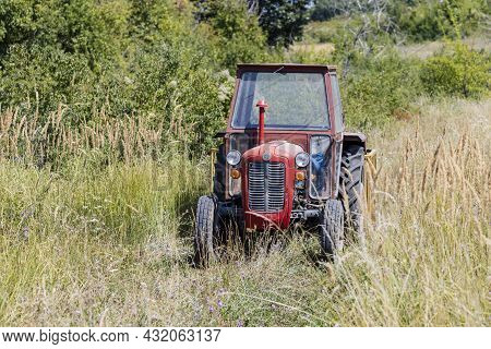 Krusevac, Serbia - 14-08-2021: Classic Imt Tractor In A Field In Central Serbia
