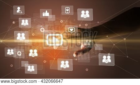 Hand pressing social media multimedia application screen with media icons on futuristic concept