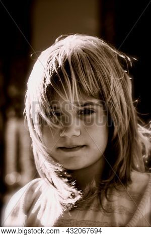 Black And White Photo Of A Blonde Girl With Wind In Her Face