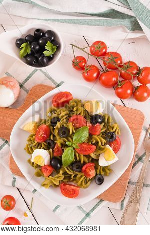 Fusilli Pasta With Cherry Tomatoes, Eggs And Black Olives.