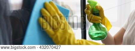 Female Hands In Yellow Gloves Wash Windows With Rag And Cleaning Agent