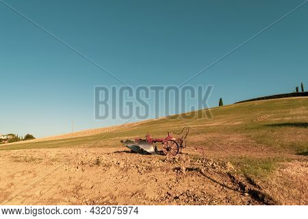 Closeup Of A Plow Standing On A Hill In The Idyllic Tuscan Countryside