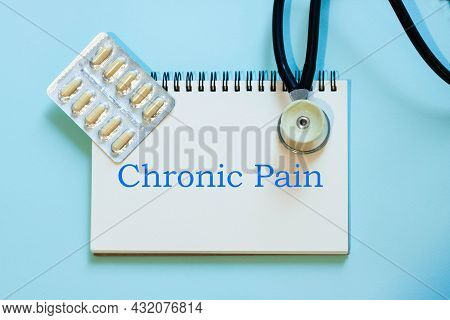 Chronic Pain - Medical Diagnosis With Stethoscope And Pills In Capsules