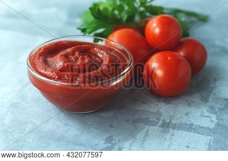 Glass Bowl With Tasty Barbecue Sauce On Table. High Quality Photo