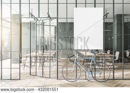 Modern Glass Partition And Bike In Stylish Coworking Office Interior With Empty Mock Up Poster And C