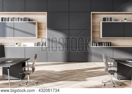 Clean Grey Coworking Office Interior With Wooden Flooring, Daylight And Furniture. Business Interior