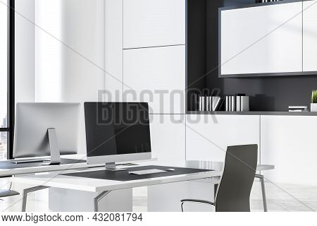 Modern White Concrete Coworking Office Interior With Daylight And Empty Comuter Screen. Business Int