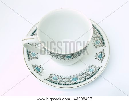 A Blank Cup Of Tea With Floral Pattern Isolated On White Background