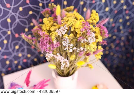 Multicolored Dried Statice Flowers In A Vase