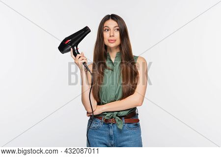 Young Woman With Shiny Hair Holding Hair Dryer Isolated On Grey