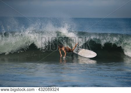 Surfer's crash on the high wave in Bali