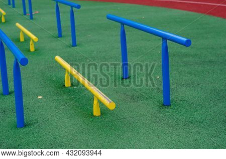 Sports Ground With Horizontal Bars For Legs And Abs. Open Area For Sports In The City Park With A Ru