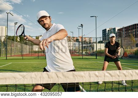 Doubles Team Of Tennis Players While Playing Tennis Match. Tennis Teamwork