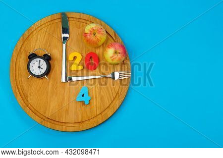 Diet Food Concept. Organic Meal. Fat Loss Concept. 20:4 Fasting Diet Concept. Blue Background. Copy