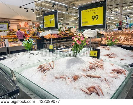 Tesco Lotus,THAILAND- August 25, 2021 : Variety of fresh meat, Fresh fish and seafood are placed in