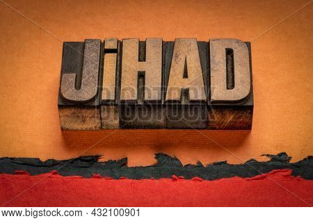 jihad, a struggle or fight against the enemies of Islam, word abstract in vintage letterpress wood type against abstract desert paper landscape