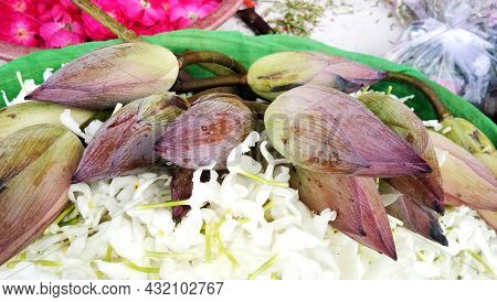 Lotus Flower Bud With White Flowers In A Basket For Puja Ceremony On The Banks Of Ganga River In Var