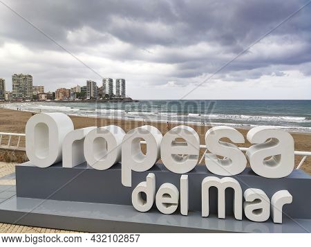 Letters Of The Oropesa Del Mar Municipality With The Mediterranean Sea On A Day With Cloudy And Gray