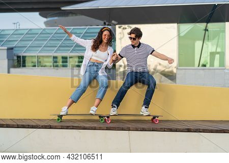 Cheerful Hipster Man And Woman Young Couple Having Fun After Skateboarding Laugh Enjoy Time Outdoors