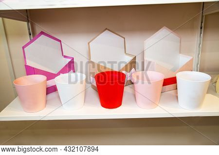 Ceramic Pots And Boxes With Bows Of Red, Pink, White Colors Standing On The Shelf. Packaging Florist