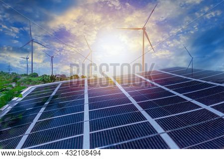 Solar Panels And Wind Power Stations. Renewable Energy Wind And Solar Generation. Defocused Photo Wi