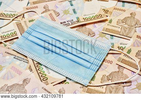 Uzbek Currency Sum Weakening During Covid-19 Pandemic. Pile Of Uzbek Sum Currency Money Bill And Med