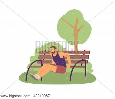 Young Man In Sportswear Doing Sport Exercises, Training Push-ups From Bench.