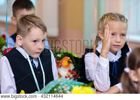 The First Grader Raises Her Hand In The Lesson, Wants To Give An Answer. At School, September 1 Is T