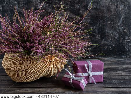 Autumn Composition Of Heather In A Wicker Basket And Gifts, Still Life