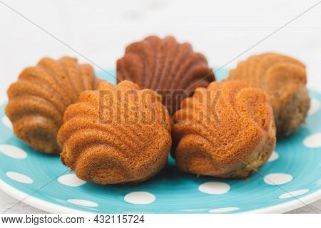 Madeleine Cakes With A Distinctive Shell-like Shape On White Background For Bakery, Food And Eating