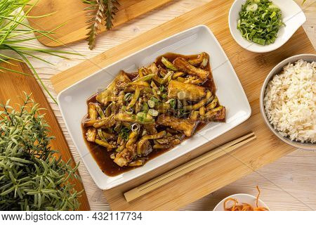 Top View Of Bamboo Shoots And Zucchini In Spicy Sauce Served With Rice
