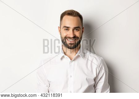 Close-up Of Confident Male Employee In White Collar Shirt Smiling At Camera, Standing Self-assured A