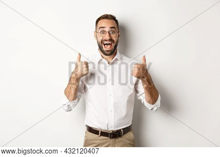 Excited Man In Glasses Showing Thumbs Up And Looking Amazed, Agree And Approve Something Great, Reco