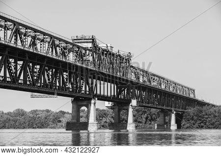 Black And White Photo Of Danube Bridge. A Truss Bridge Over The Danube River Connecting Bulgarian An