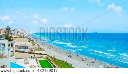 La Manga, Spain - July 29, 2021: A panoramic view over the Blanco del Tabal beach in La Manga del Mar Menor, in the Region of Murcia, Spain. It is an important summer tourist destination in Spain